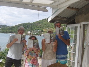 """Island in the Clouds"" readers near a Bequia beach ..."